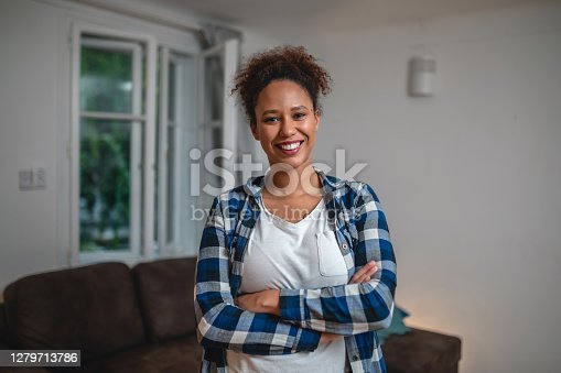 Portrait of a contented mixed race woman at home
