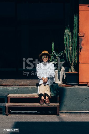 Outdoor portrait of a stylish young Asian woman.