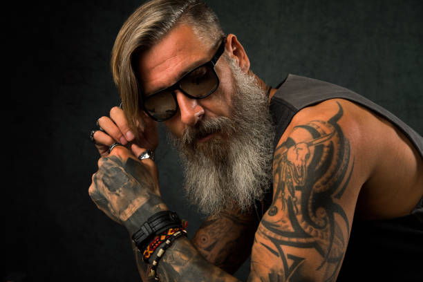 Portrait of a cool biker with sunglasses stock photo