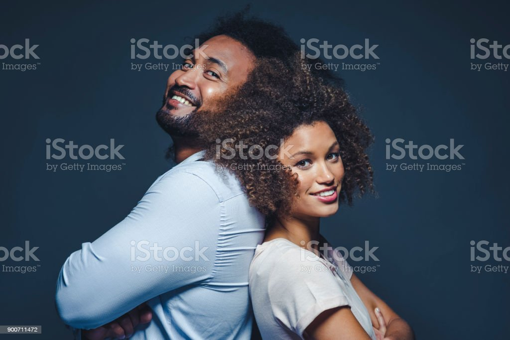 Portrait of a couple of mixed race ethnicity on black background stock photo
