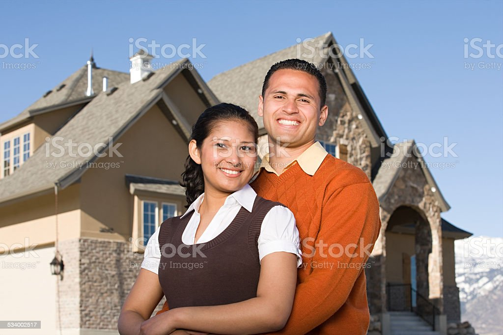 Portrait of a couple outside of a house stock photo