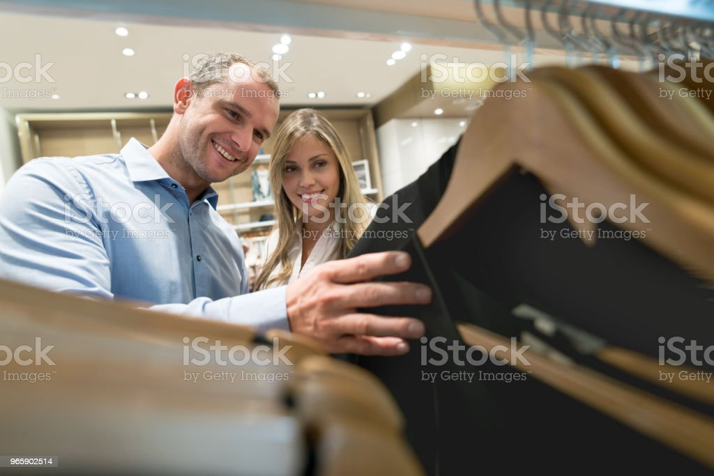 Couple shopping for clothes at a store - Royalty-free 30-39 Years Stock Photo
