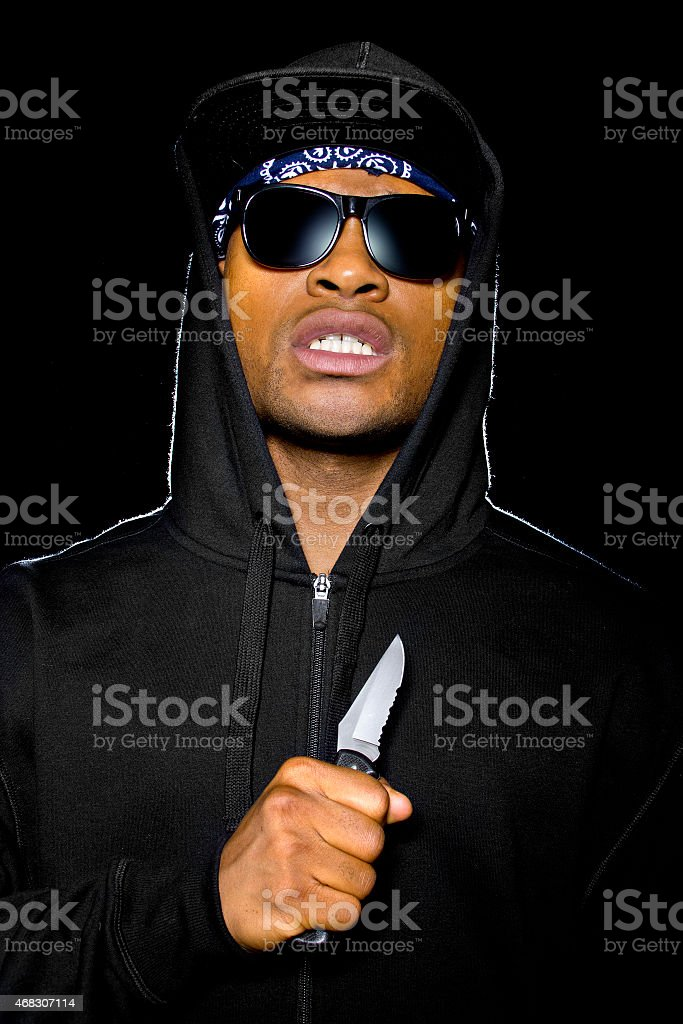 Portrait of a Criminal With a Knife stock photo