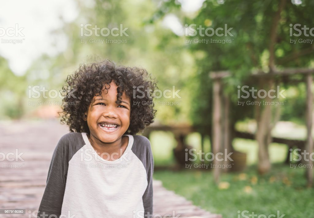 portrait of a cute african american little boy smiling. stock photo