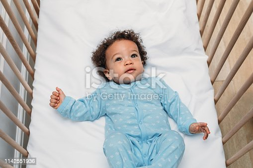 Portrait of a cute baby boy wearing pajamas