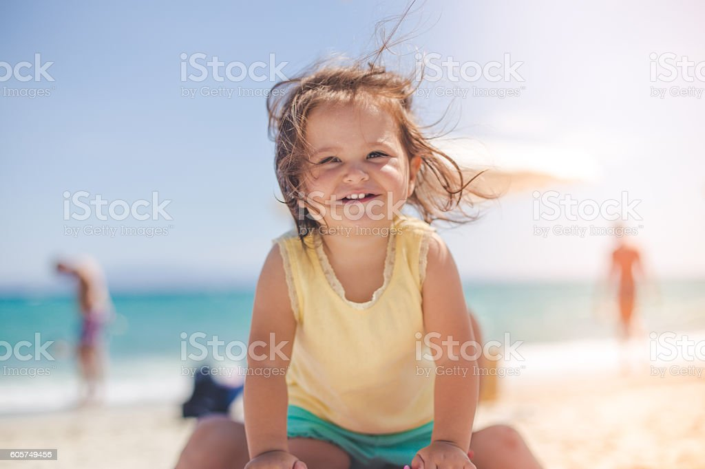 portrait of a cute baby girl on the beach – Foto