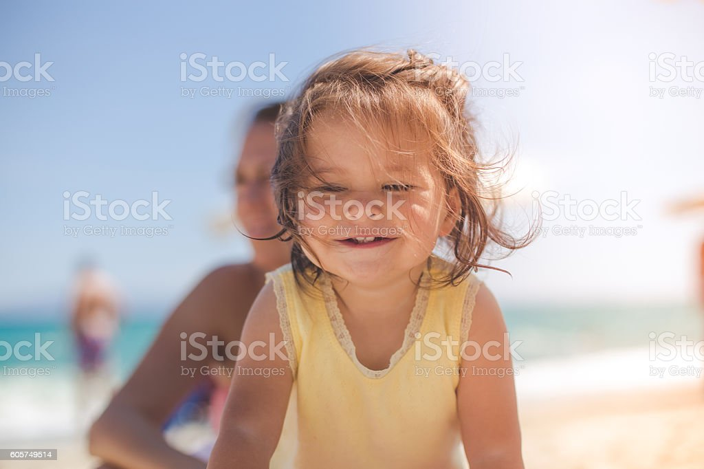 Portrait of a cute baby girl on the beach stock photo