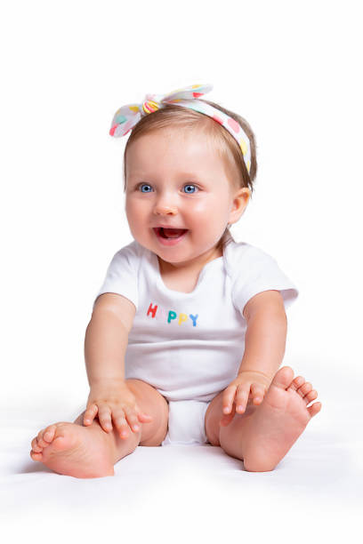 Portrait of a cute baby girl with blue eyes stock photo