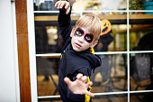 istock Portrait of a cute funny kid in carnival costume posing on the street 1282992078