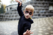 istock Portrait of a cute funny kid in carnival costume posing on the street 1282992093