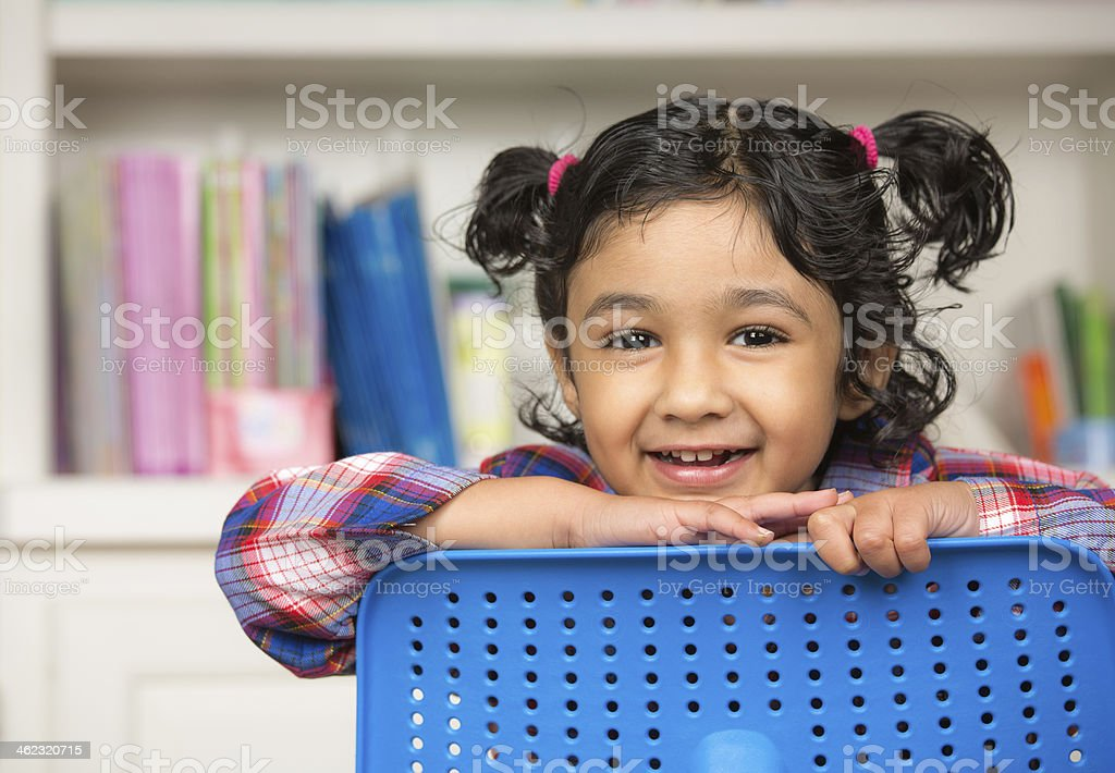 Portrait of a Cute Little Gil in the Classroom stock photo