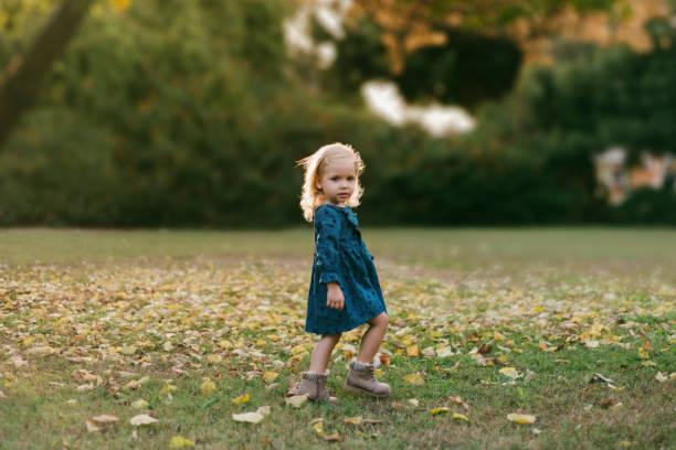 Portrait of a cute little girl in a public park stock photo