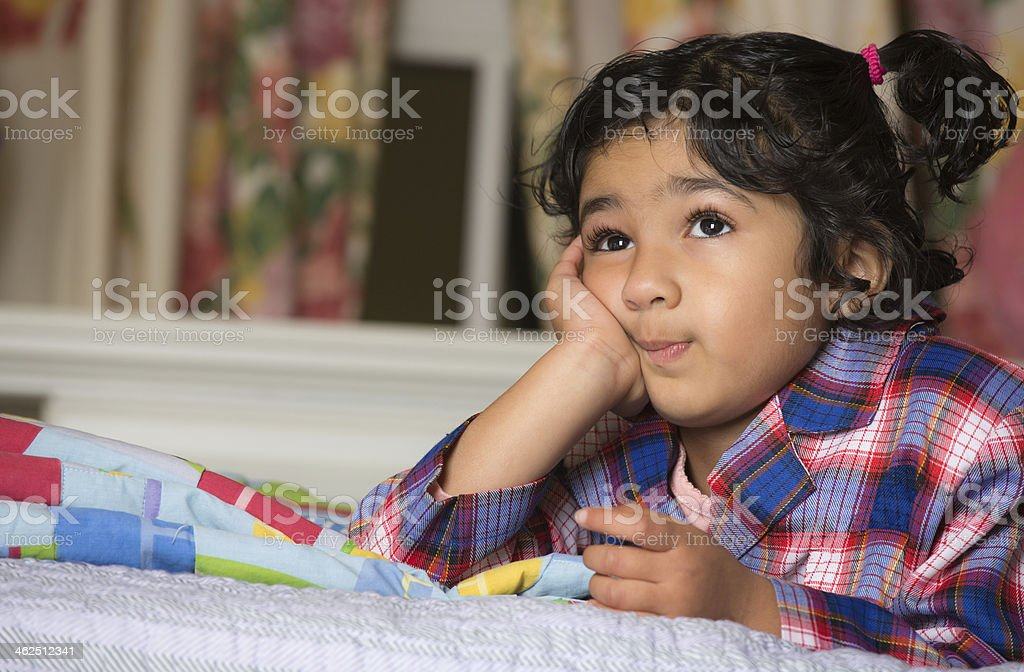 Portrait of a Cute Little Girl Lost in Thought stock photo