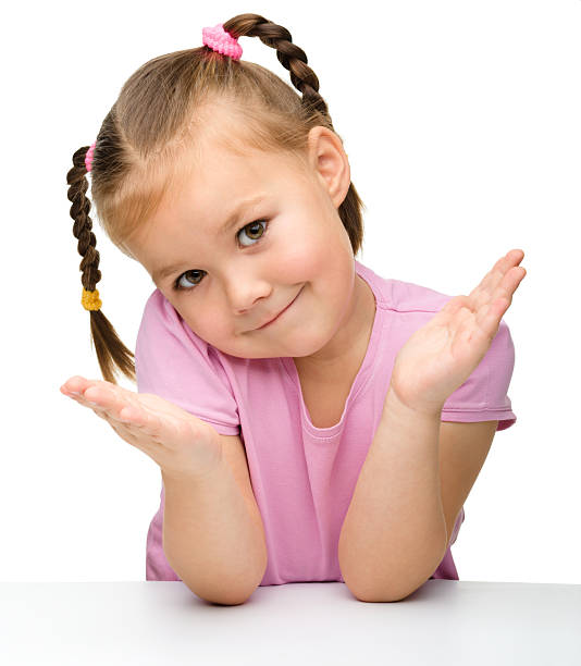 royalty free cute little girl shrugging and smiling pictures images