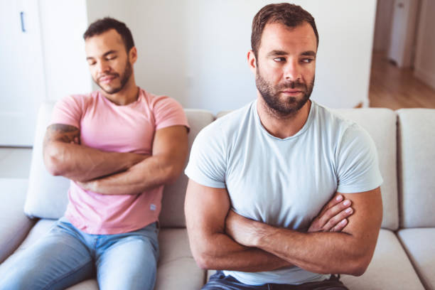 Portrait of a Cute Male gay homosexual Couple at Home stock photo