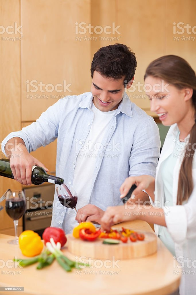 Portrait of a cute man pouring one glass royalty-free stock photo