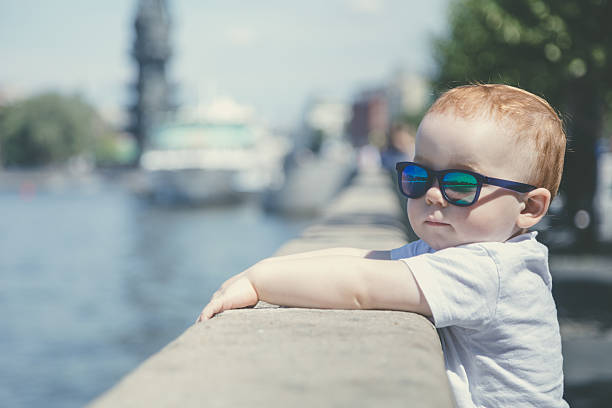 Portrait of a cute red-haired boy in sunglasses stock photo