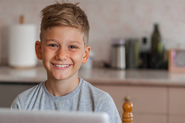 Portrait of a cute smiling boy looking at camera Portrait of a cute smiling boy looking at camera 8 9 years stock pictures, royalty-free photos & images