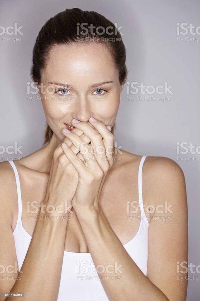 Portrait of a cute young female with hands over mouth royalty-free stock photo