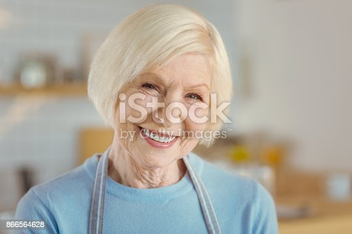 istock Portrait of a delighted aged woman 866564628