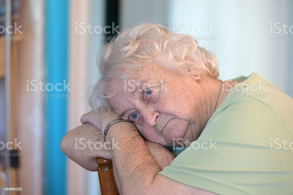Portrait of a depressed old lady stock photo