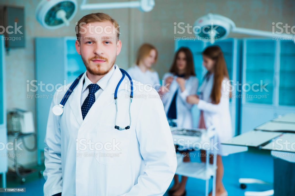 Portrait of a doctor intern. Medical students profession staff....