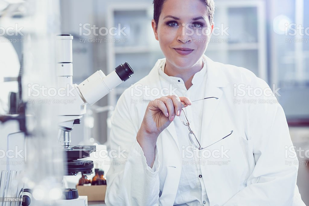 Portrait of a Doctor of Science by the Microscope stock photo