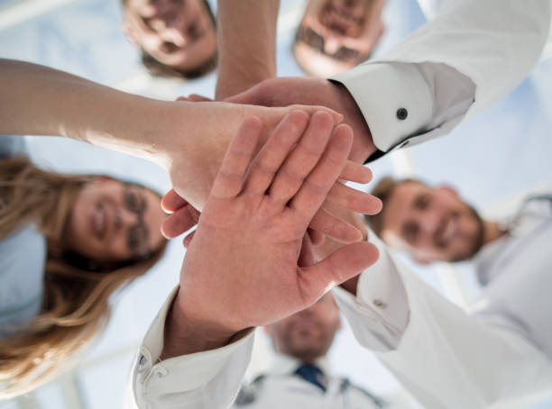 Portrait of a doctor team connecting hands stacking stock photo