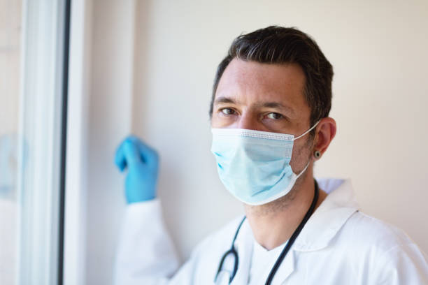 Portrait of a doctor with protective facial mask stock photo