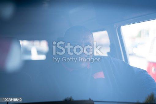 635967404 istock photo Portrait of a Driver 1002848840