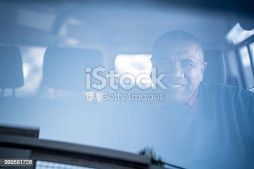 635967404 istock photo Portrait of a Driver 999591728