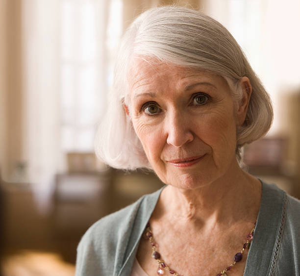 Portrait of a elderly woman  65 69 years stock pictures, royalty-free photos & images