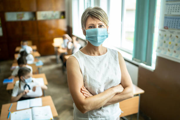 COVID-19. Portrait of a elementary teacher wearing protective face mask