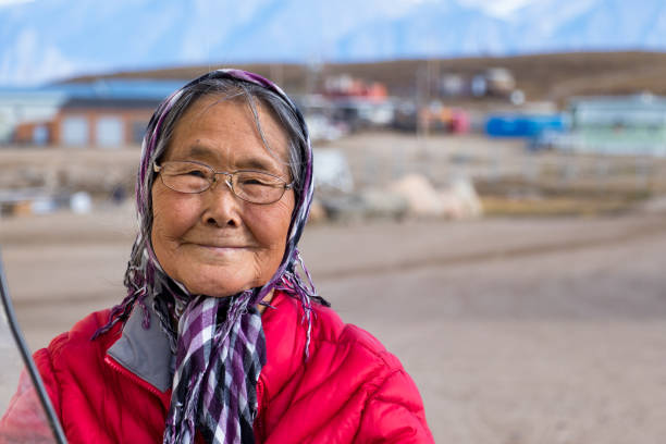 Portrait of a eskimo - inuit senior woman outdoors in Pond Inlet, Baffin Island, Canada. stock photo