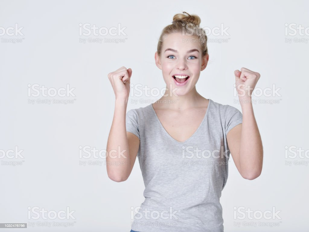 Portrait of a excited woman with positive emotions - on white...