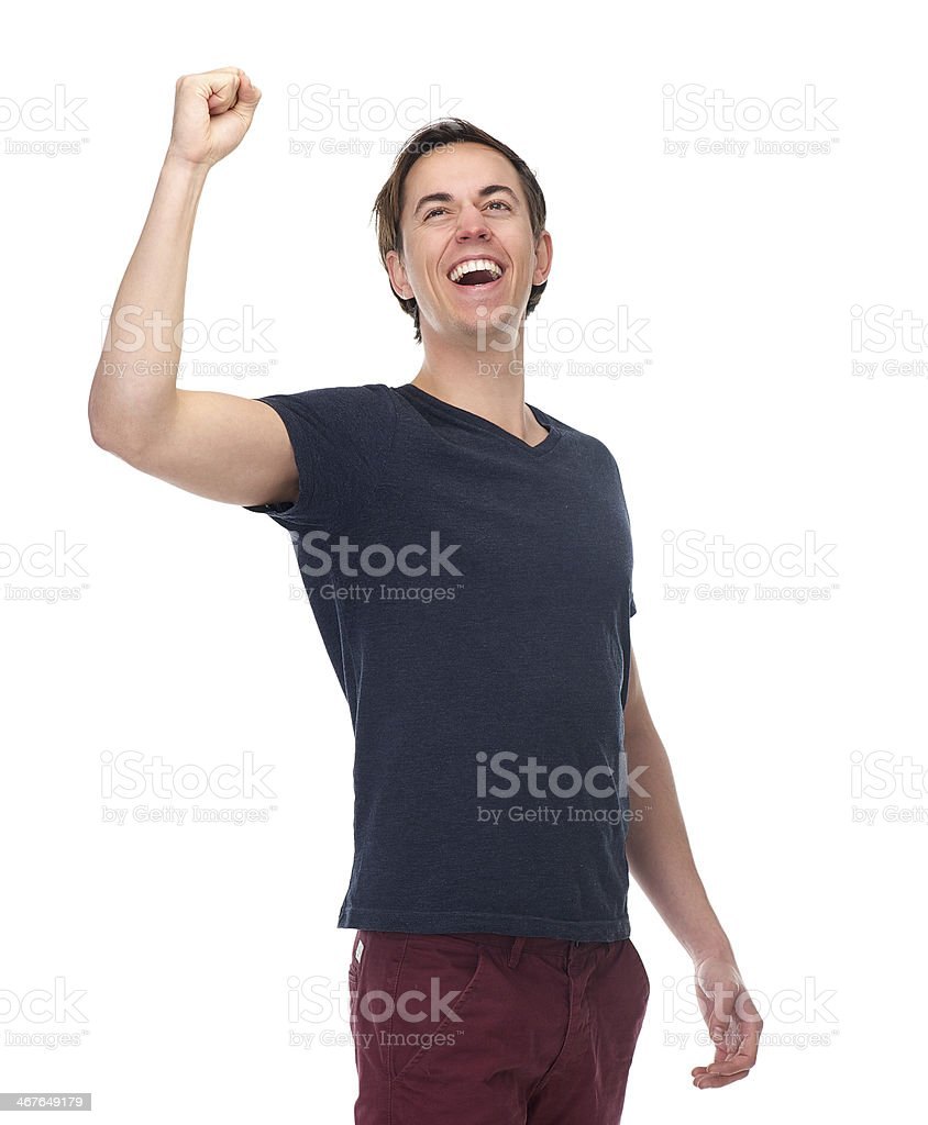 Portrait of a excited young man with arm raised up royalty-free stock photo