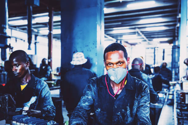 Portrait of a Factory Worker Wearing Protective Mask stock photo