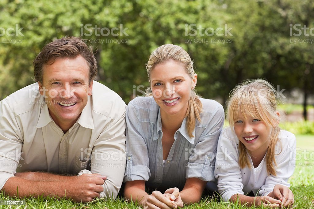 Portrait of a family relaxing at park royalty-free stock photo