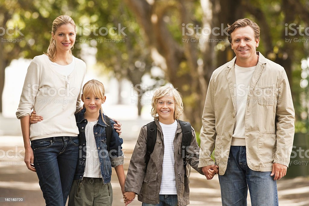 Portrait of a family smiling while holding hands royalty-free stock photo