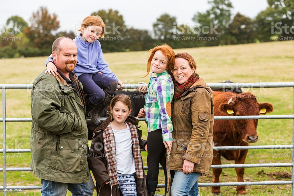 Portrait of a Farming Family Outdoors in the Field stock photo