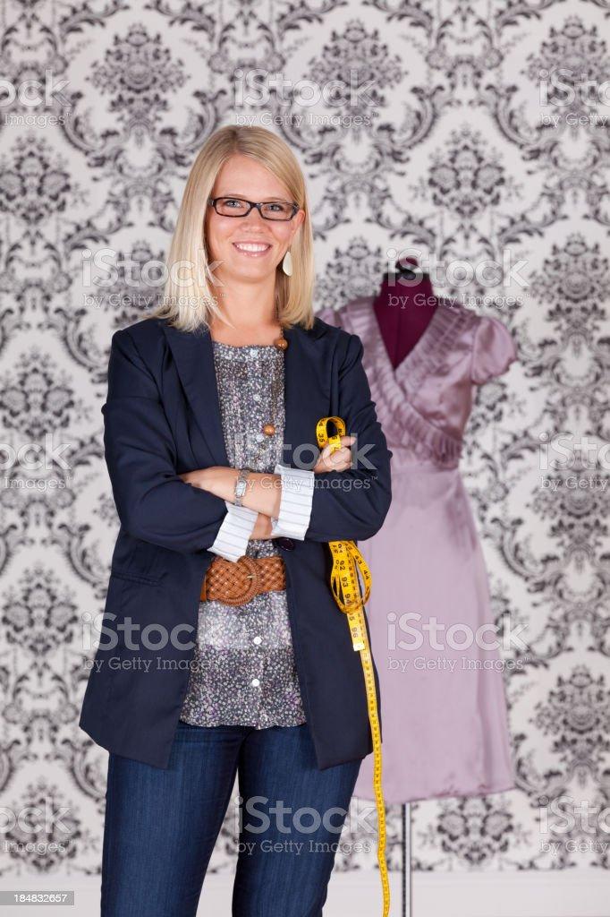 Portrait of a fashion designer smiling royalty-free stock photo