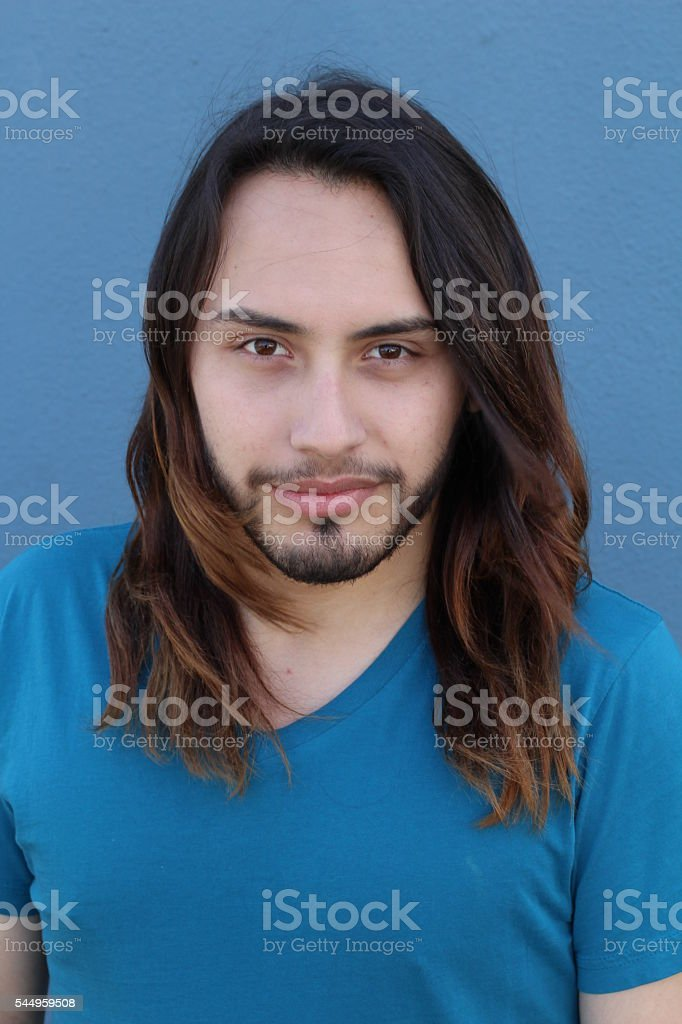 Portrait of a fashionable young man with a trendy long hair stock photo
