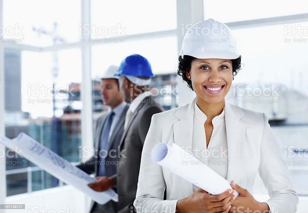 Portrait of a female architect with colleagues in the background royalty-free stock photo