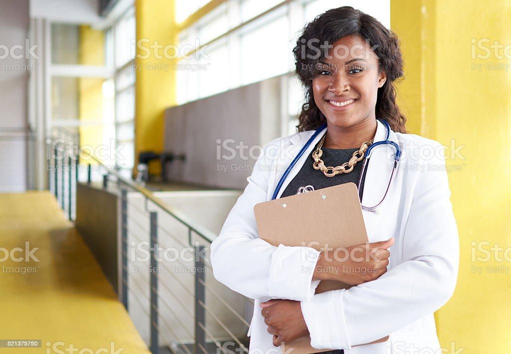 Portrait of a female doctor holding her patient chart in stock photo