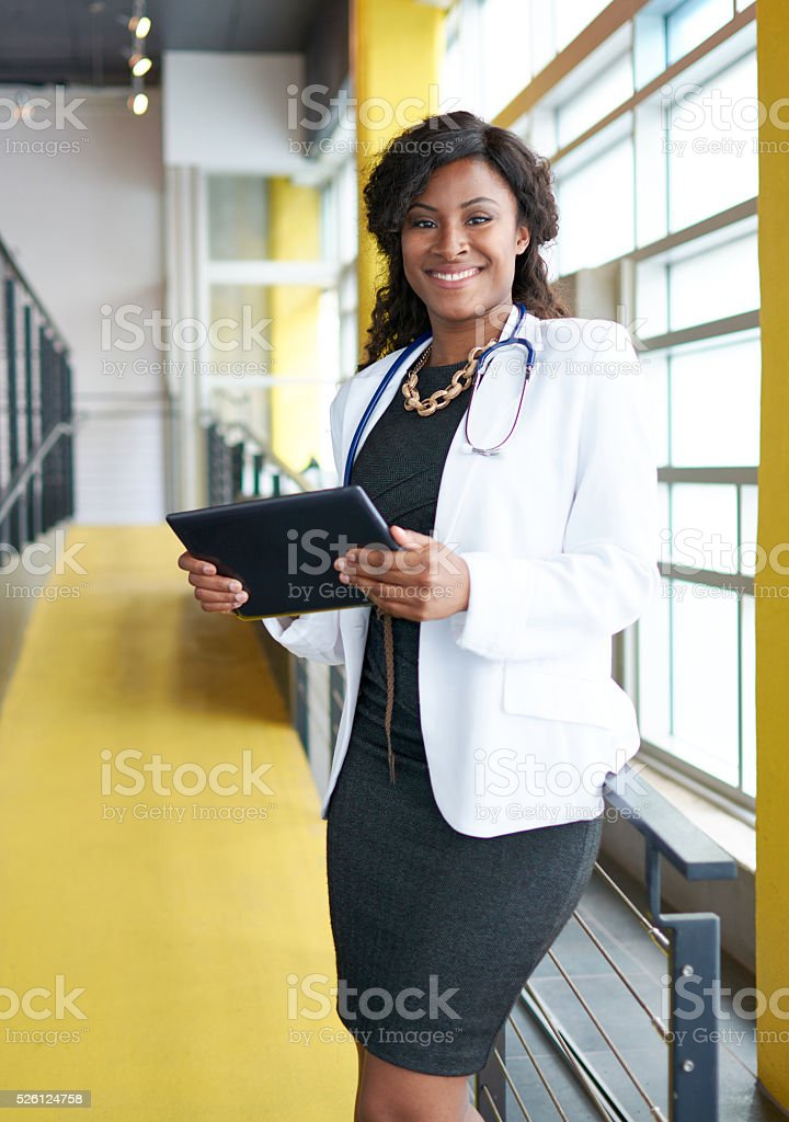 Portrait of a female doctor holding her patient chart on stock photo