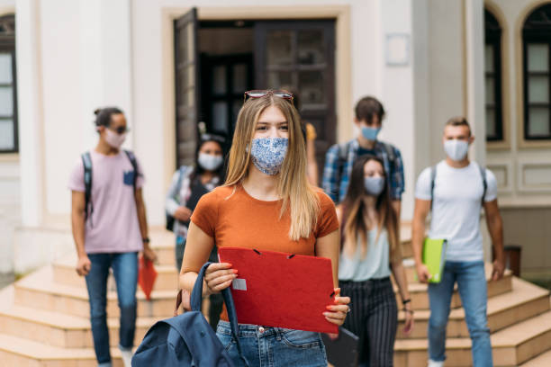 Portrait of a female high school student wearing a protective face mask stock photo