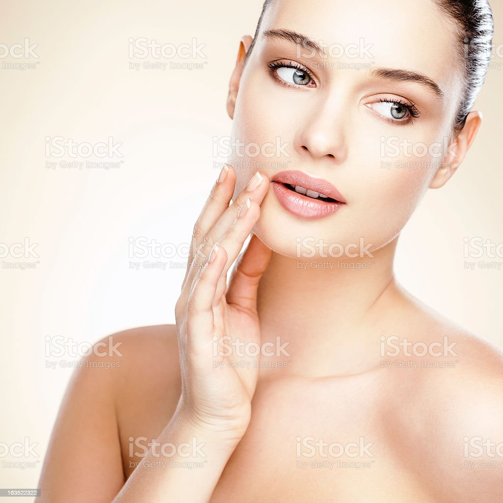 Portrait of a female lightly touching her face royalty-free stock photo