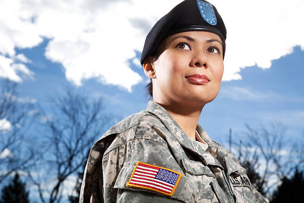 Portrait of a female military soldier Portrait of a female soldier wearing Universal Camouflage Uniform or ACU & Beret. beret stock pictures, royalty-free photos & images