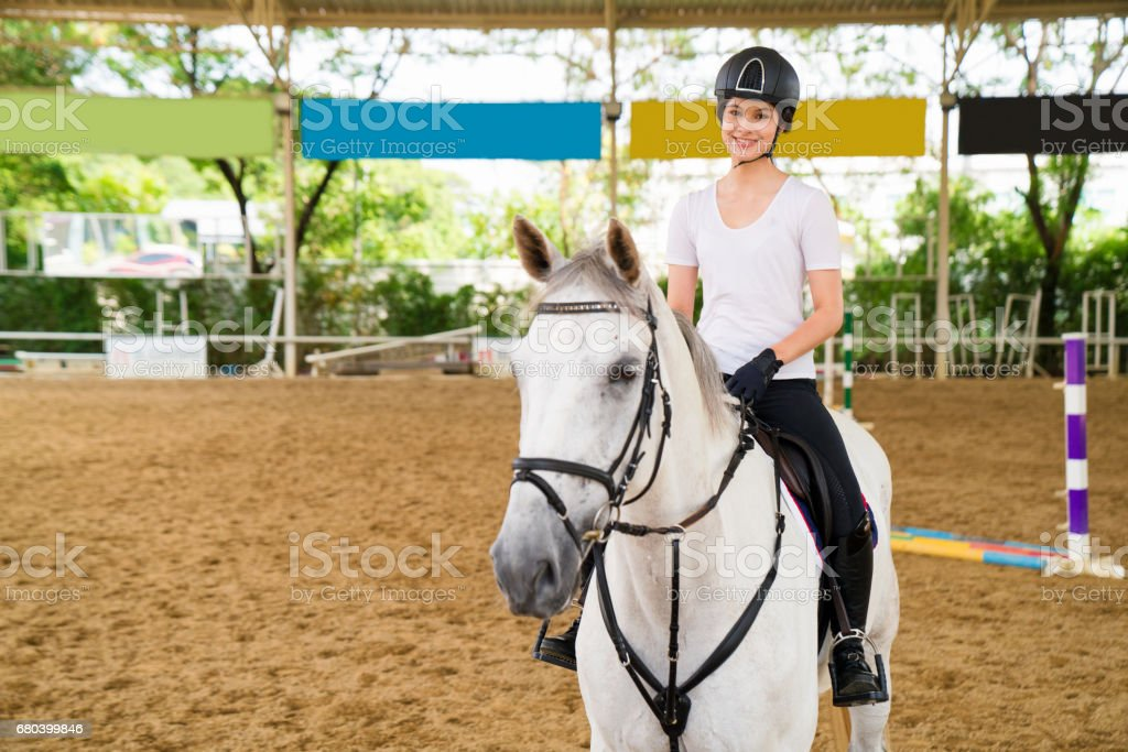 Portrait of a female rider sitting on her horse stock photo