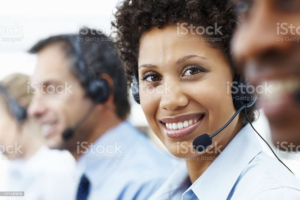 Portrait of a female telephonist working with her colleagues royalty-free stock photo